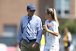 15 September 2013: UNC head coach Anson Dorrance (left) talks with Kealia Ohai (7) at halftime. The University of North Carolina Tar Heels hosted the University of Notre Dame Fighting Irish at Fetzer Field in Chapel Hill, NC in a 2013 NCAA Division I Women's Soccer match. Notre Dame won the game 1-0.