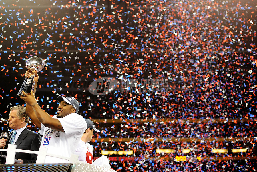 Feb 5, 2012; Indianapolis, IN, USA; New York Giants wide receiver Hakeem Nicks (88) holds the Vince Lombardi Trophy after the Giants defeated the New England Patriots 21-17 in Super Bowl XLVI at Lucas Oil Stadium.  Mandatory Credit: Mark J. Rebilas-.