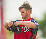22 February 2013: Washington Nationals' outfielder Bryce Harper stretches out a new cap during a full squad Spring Training workout at Space Coast Stadium in Viera, Florida. Mandatory Credit: Ed Wolfstein Photo *** RAW File Available ***