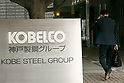 A man walks past a signboard of Kobe Steel (KOBELCO) on display outside its headquarters in Tokyo on October 12, 2017, Japan. Hiroya Kawasaki, President and CEO of Kobe Steel, told reporters today that company's reputation plunged to zero after the firm admitted last Sunday to falsifying inspection data on products used in planes, trains, automobiles and defense equipment. The government ordered Japan's third-biggest steelmaker to deal with safety checks with its local and overseas clients. International firms such as General Motors, Boeing and Toyota have started to examine their models for parts sourced from Kobe Steel. (Photo by Rodrigo Reyes Marin/AFLO)