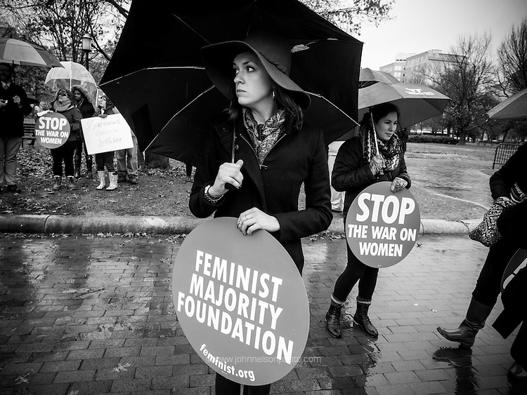 A participant carries a sign at a rally calling on president Obama to ensure the United States is a leader in providing comprehensive, post-rape care, including safe abortion services, to survivors of sexual violence. The rally took place in front of the White House in Washington, DC. <br /> <br /> PHOTOS/John Nelson