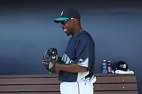 PEORIA - MARCH 5:  Chone Figgins of the Seattle Mariners gets ready in the dugout before a spring training game against the San Diego Padres on March 5, 2010 at the Peoria Sports Complex in Peoria, Arizona. (Photo by Brad Mangin)