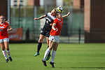 Vicky Krug (4) of the Wake Forest Demon Deacons battles for a jump ball with Mackenzie Smith (3) of the Clemson Tigers during second half action at Riggs Field on October 22 2017 in Clemson, South Carolina.  The Tigers defeated the Demon Deacons 2-1. (Brian Westerholt/Sports On Film)