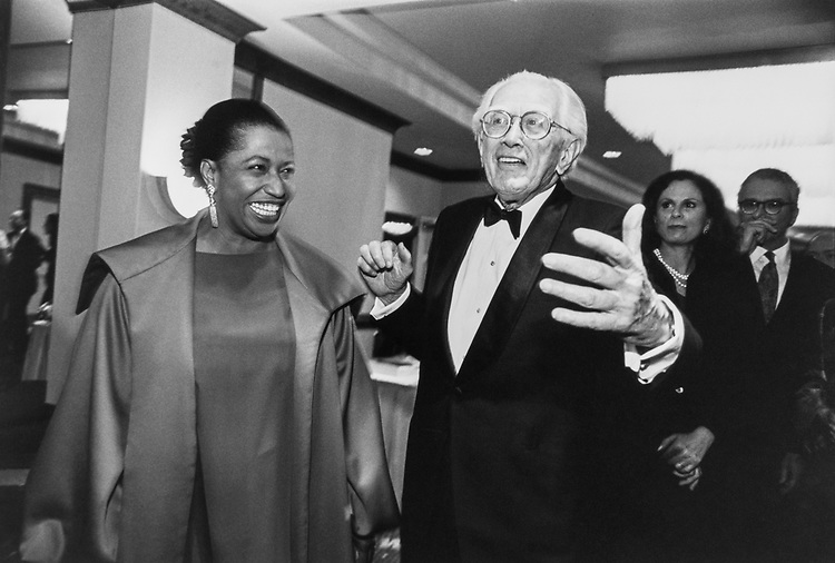 Sen. Howard Metzenbaum, D-Ohio with Carol Moseley Braun at DSCC dinner. Howard Metzenbaum was saying that he should be photographed, but all of a sudden everyone wants to photograph him with the female candidates on Sept. 23, 1992. (Photo by Kathleen Beall/CQ Roll Call)