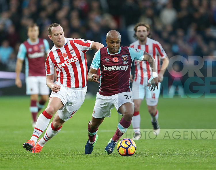 West Ham's Andre Ayew tussles with Stoke's Charlie Adam during the Premier League match at the London Stadium, London. Picture date November 5th, 2016 Pic David Klein/Sportimage