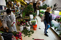 NEW YORK, NY - MAY 10: A woman wearing a face mask looks the plants at the Garden Center in Jackson Heights on Mother's Day on May 10, 2020 in Queens, New York. COVID-19 has spread to most countries in the world, claiming more than 283,000 lives and more than 4.1 million people infected, Queens has been one of the places most affected by the Coronavirus. (Photo by Pablo Monsalve / VIEWpress via Getty Images)