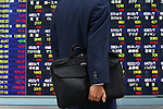 June 21, 2010 - Tokyo, Japan - A pedestrian walks past an electronic stock board at the Tokyo Stock Exchange in Tokyo, Japan, on May 21, 2010. The Nikkei 225 Stock Average rose 242.99 points, or 2.4%, to 10238.01, its highest closing level since May 18.