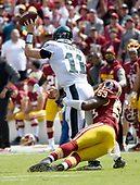 Philadelphia Eagles quarterback Carson Wentz (11) gets rid of the ball before being sacked by Washington Redskins linebacker Zach Brown (53) in the second quarter against the Philadelphia Eagles at FedEx Field in Landover, Maryland on Sunday, September 10, 2017.<br /> Credit: Ron Sachs / CNP