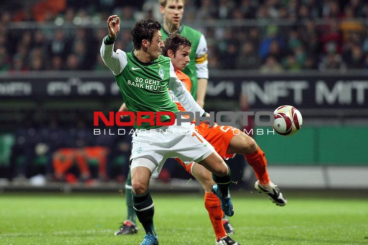 UEFA Euro League 2009/2010 Werder Bremen 05.11.2009<br /> <br /> Weserstadion Gruppenphase Gruppe L<br /> <br /> Werder Bremen (GER) - Austria Wien (AUT)<br /> <br /> <br /> <br /> Per Mertesacker (GER Werder Bremen #29), Mesut &Ouml;zil (GER Werder Bremen #11) und Emin Sulimani (#23 Wien).<br /> <br /> <br /> <br /> Foto &copy; nph ( nordphoto ) *** Local Caption *** *** Local Caption *** <br /> Fotos sind ohne vorherigen schriftliche Zustimmung ausschliesslich f&uuml;r redaktionelle Publikationszwecke zu verwenden.<br /> <br /> Auf Anfrage in hoeherer Qualitaet/Aufloesung