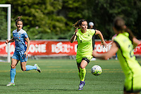 Seattle, WA - Sunday, May 22, 2016: Seattle Reign FC defender Rachel Corsie (4) looks to pass the ball during a regular season National Women's Soccer League (NWSL) match at Memorial Stadium. Chicago Red Stars won 2-1.