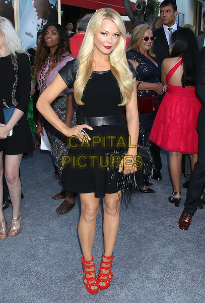 Charlotte Ross<br /> &quot;Elysium&quot; Los Angeles Premiere held at the Regency Village Theatre, Westwood, California, UK,<br /> 7th August 2013.<br /> full length black dress hand on hip red shoes leather sleeves waistband feather clutch bag <br /> CAP/ADM/RE<br /> &copy;Russ Elliot/AdMedia/Capital Pictures
