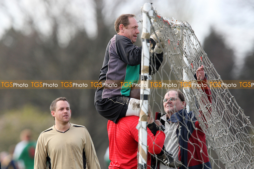 The Gascoyne FC goalkeeper is lifted by a team mate to put the goal net up prior to a Hackney & Leyton Sunday League match at Hackney Marshes - 30/03/08 - MANDATORY CREDIT: Gavin Ellis/TGSPHOTO - Self billing applies where appropriate - Tel: 0845 094 6026