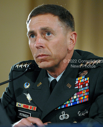Washington, D.C. - September 10, 2007 -- United States Army General David H. Petraeus, Commander of the Multi-National Force - Iraq (MNF-I), testifies on the future course of the war in Iraq while appearing before a joint hearing of the United States House Armed Services Committee and United States House Foreign Relations Committee, Monday, September 10, 2007, on Capitol Hill in Washington..Credit: Ron Sachs / CNP