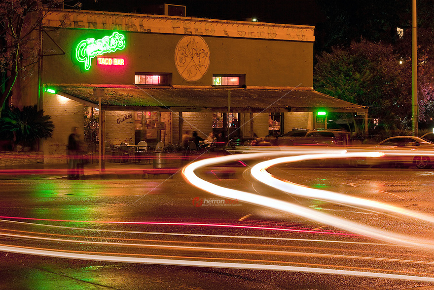 Nighttime view of Gueros Taco Bar, a popular South Congress Avenue favorite for gathering of family and friends - Stock Image.