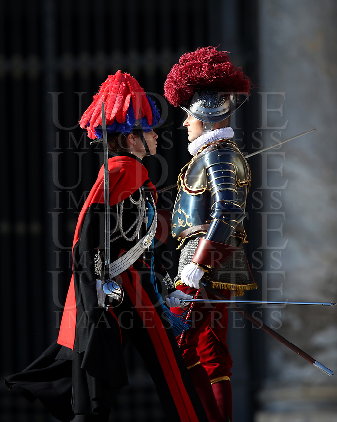 A Carabinieri officer in full uniform passes past a Swiss Guard in full uniform before the Pope Francis' Urbi et Orbi (To the City and to the World) blessing on the occasion of the Christmas day from the central loggia of St. Peter's Basilica at the Vatican, on December 25, 2019.<br /> UPDATE IMAGES PRESS/Isabella Bonotto<br /> <br /> STRICTLY ONLY FOR EDITORIAL USE