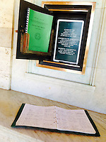 Pictured: The visitors' book at the World War II cemetery in Souda, near Chania, Crete, Greece. Tuesday 08 July 2014<br /> Re: Police from north Wales helping in the search for a missing Denbigh pensioner in Crete want to track down two Welsh tourists who visited the Greek island.<br /> Arthur Jones, 73, from Denbighshire, has not been seen since 19 June, two days after he arrived in Crete.<br /> The officers found Mr Jones's name in a visitors' book from the day before he disappeared, written just before two Welsh tourists signed it.<br /> They hope Mr Jones might have spoken to them of his plans for a walking tour.