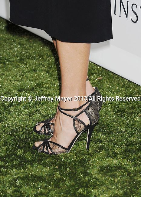 CULVER CITY, CA- NOVEMBER 09: Actress Julie Bowen (shoe detail) at the 2nd Annual Baby2Baby Gala at The Book Bindery on November 9, 2013 in Culver City, California.