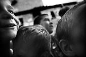 Wroclaw 10.11.2007 Poland<br /> The worst and the most dangerous district in Wroclaw ( Poland ) , called by people &quot;The Bermuda Triangle&quot;. There are walls bearing an inscription &quot;Who will enter here, will not exit alive&quot; Many families there are pathological and live in extreme poverty. Children have no place for any games so they loaf around on this wasted district and disseminate a juvenile delinquency. Many of them become sexually active though they are only 10-12 years old<br /> (Photo by Adam Lach / Napo Images)<br /> <br /> Najbardziej nabezpieczna dzielnica we Wroclawiu zwana przez ludzi Trojkatem Bermudzkim. Sa tam sciany opatrzone napisem &quot; Kto tu wejdzie, nigdy nie wyjdzie stad zywy&quot; Mieszka tam wiele rodzin patologicznych i zyja w wielkiej nedzy. Dzieci wlocza sie po ulicach nie majac miejsc na zabawe i szerza przestepczosc wsrod nieletnich. Wiele z dzieci uprawia seks choc maja zaledwie 10-12 lat<br /> (Fot Adam Lach / Napo Images)