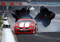 Apr 29, 2016; Baytown, TX, USA; NHRA  pro mod driver Jonathan Gray loses control after blowing a rear tire during qualifying for the Spring Nationals at Royal Purple Raceway. Gray was uninjured. Mandatory Credit: Mark J. Rebilas-USA TODAY Sports