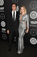 SANTA MONICA, CA - JANUARY 06: Actors Hayes MacArthur (L) and Ali Larter arrive at the The Art Of Elysium's 11th Annual Celebration - Heaven at Barker Hangar on January 6, 2018 in Santa Monica, California.<br /> CAP/ROT/TM<br /> &copy;TM/ROT/Capital Pictures