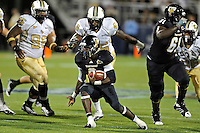 17 September 2011:  FIU running back Kedrick Rhodes  (9) carries the ball in the second half as the FIU Golden Panthers defeated the University of Central Florida Golden Knights, 17-10, at FIU Stadium in Miami, Florida.