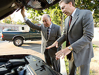 We encourage you to use these photographs for all official purposes.  The photographs are not intended to be used in campaign materials or for campaign purposes. ..Caption: Senator Ken Salazar (D) Colorado inspects the engine of a Ford Crown Victoria at an event to promote the 25 x '25 congressional legislation.  Seen with him is Ford's Jerry Roussel Manager of Environmental and Safety Issues....© 2006 Mark finkenstaedt.  For GM Corp.  PR and Media Outreach use for One year from the date of the event.  No Annual report use.  No advertising use.  Please call the photographer for additional use 202-258-2613  mark@mfpix.com