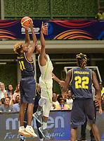 MEDELLÍN - COLOMBIA, 25-08-2017: Bruno CABOCLO de Brasil salta por el balón con Braian ANGOLA de Colombia durante partido de la fase de grupos, grupo A, de la FIBA AmeriCup 2017 jugado en el coliseo Iván de Bedout de la ciudad de Medellín.  El AmeriCup 2017 se juega  entre el 25 de agosto y el 3 de septiembre de 2017 en Colombia, Argentina y Uruguay. / Bruno CABOCLO of Brazil jumps for the ball with Braian ANGOLA of Colombia during the match of the group stage Group A of the FIBA AmeriCup 2017 played at Ivan de Bedout  coliseum in Medellin. The AmeriCup 2017 is played between August 25 and September 3, 2017 in Colombia, Argentina and Uruguay. Photo: VizzorImage / León Monsalve / Cont