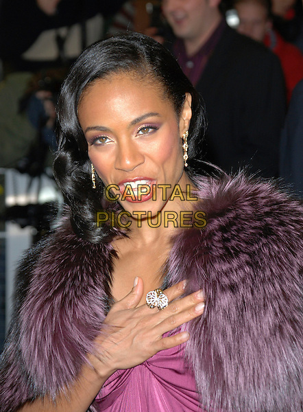 """JADA PINKETT SMITH.Attends the UK Film Premiere of """"The Pursuit of Happyness"""", Curzon  Mayfair Cinema, London, England, 8th January 2007..portrait headshot pink purple dress fur shrug cropped jacket wrap hand ring.CAP/CAN.©Can Nguyen/Capital Pictures"""