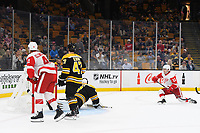 September 26, 2018: Detroit Red Wings defenseman Filip Zadina (11) scores qthe game winning goal against Boston Bruins goaltender Jaroslav Halak (41) during the NHL pre-season game between the Detroit Red Wings and the Boston Bruins held at TD Garden, in Boston, Mass. Detroit defeats Boston 3-2 in overtime. Eric Canha/CSM
