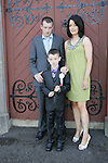 Reece Dunne-Sharkey made his first Communion at Clogherhead church on Saturday. Here he is with his mum Ruth and dad Robert.