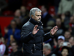 Jose Mourinho manager of Manchester United gestures to the fans as he walks off during the English Premier League match at Old Trafford Stadium, Manchester. Picture date: December 11th, 2016. Pic Simon Bellis/Sportimage