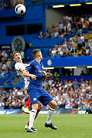 Chris Basham of Sheffield United and Jorginho of Chelsea compete for a ball during the Premier League match between Chelsea and Sheff United at Stamford Bridge, London, England on 31 August 2019. Photo by Carlton Myrie / PRiME Media Images.