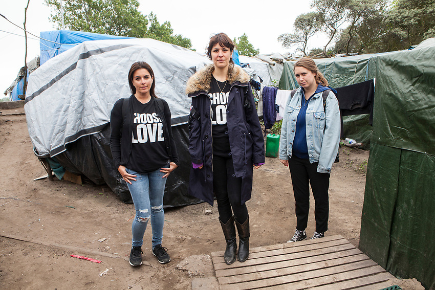 "left to right Dani Lawrence, Liana Bird and Josie Naughton who are the main figures of Help Refugees UK.  Photographed in ""The Jungle"" refugee camp in Calais France. Help Refugees has grown out of #helpcalais, a social media campaign started by Lliana Bird (Radio X DJ), Dawn O'Porter (Writer and Presenter), Josie Naughton and Heydon Prowse (The Revolution will be Televised) to raise a few funds and collect goods to take to Calais to help in some small way. The public response to the campaign was huge, and we were quickly able to provide aid in Calais and far beyond. Dani Lawrence' involvement begin when she filled a car with supplies and donations and drove to Calais."