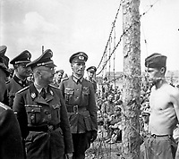 Himmler besichtigt die Gefangenenlager in Russland.  Heinrich Himmler inspects a prisoner-of-war camp in Russia.  Ca. 1940-41.  Heinrich Hoffman Collection.  (Foreign Record Seized)<br /> Exact Date Shot Unknonw<br /> NARA FILE #:  242-HB-47721-306<br /> WAR &amp; CONFLICT BOOK #:  1275