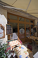 Menu and table and chairs outside restaurant La Rochelle Charente-Maritime France.