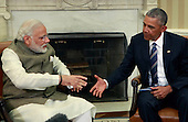 United States President Barack Obama greets Prime Minister Narendra Modi of India in the Oval Office of the White House in Washington, DC on June 7, 2016.  During their meeting the leaders discussed a number of topics including cybersecurity, climate change, and economic cooperation.<br /> Credit: Dennis Brack / Pool via CNP
