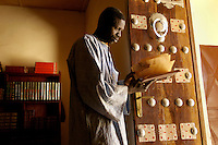 At Timbuktu's Ahmed Baba Centre in Mali, librarian Al Wangari holds a manuscript. Over the past years, with funding from different organizations including the Ford Foundation, thousands of the manuscripts are being recovered, stored, preserved and studied. Timbuktu's manuscripts are varied in both length and subject. Their topics are as diverse as science, medicine, history, human rights, law, poetry and literature. A majority of them are religious in nature, such as handwritten Korans, accounts of the life of the Prophet, and prayers and expositions of Islamic philosophy. Sadly, many of them have been lost or severely damaged, but for those that remain, the fact that the manuscripts are being restored is a testament to the resilience of the African people and a magnificent reminder of Africa's literary history. /Felix Features