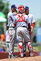 Hagerstown Suns pitching coach Sam Narron (43) talks with catcher Spencer Kieboom (20) and pitcher Justin Thomas (45) during a game against the Lexington Legends on May 19, 2014 at Whitaker Bank Ballpark in Lexington, Kentucky.  Lexington defeated Hagerstown 10-8.  (Mike Janes/Four Seam Images)