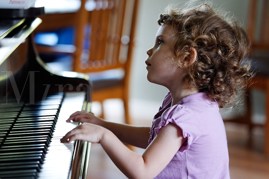 Four year old girl playing piano