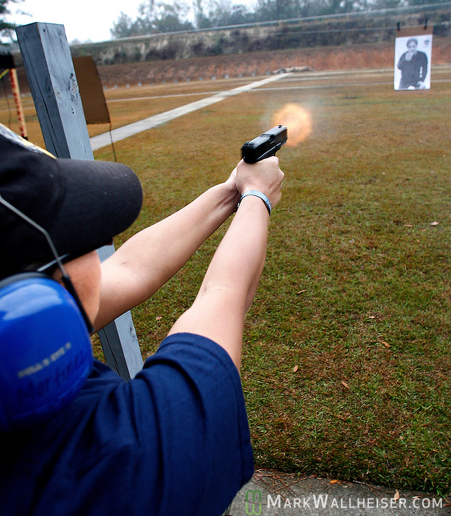 TPD recruit Maria Martinez fires at a moving target during firearms training at the Pat Thomas Law Enforcement Academy  January 09, 2007. (Mark Wallheiser/TallahasseeStock.com)