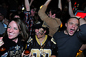 New Orleans Saints fans Gabrielle Misfeldt, Wendi Smith and Michael Pitre celebrate a Reggie Bush touchdown in the first quarter at the R Bar while watching the NFC Championship game against the Minnesota Vickings,  New Orleans, Sunday, Jan. 24, 2010..(AP Photo/Cheryl Gerber)