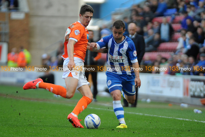 Craig Cathcart of Blackpool makes a challenge on Shaun Maloney of Wigan Athletic - Wigan Athletic vs Blackpool- Sky Bet Champiosnhip Football at the DW Stadium, Wigan - 26/04/14 - MANDATORY CREDIT: Greig Bertram/TGSPHOTO - Self billing applies where appropriate - 0845 094 6026 - contact@tgsphoto.co.uk - NO UNPAID USE