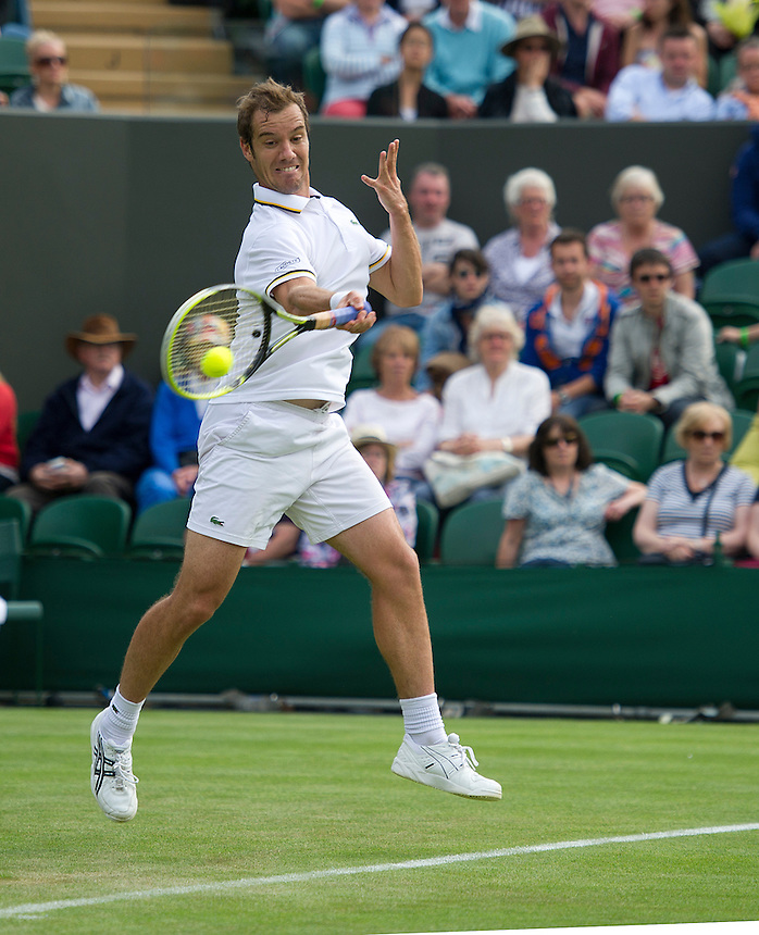 Richard Gasquet (FRA) in action during his victory over Marcel Granollers (ESP) in their Gentlemen's Singles First Round match today - Richard Gasquet (FRA) [9] def Marcel Granollers (ESP) 6-7(2) 6-4 7-5 6-4 <br /> <br />  (Photo by Stephen White/CameraSport) <br /> <br /> Tennis - Wimbledon Lawn Tennis Championships - Day 2 Tuesday 25th June 2013 -  All England Lawn Tennis and Croquet Club - Wimbledon - London - England<br /> <br /> &copy; CameraSport - 43 Linden Ave. Countesthorpe. Leicester. England. LE8 5PG - Tel: +44 (0) 116 277 4147 - admin@camerasport.com - www.camerasport.com.