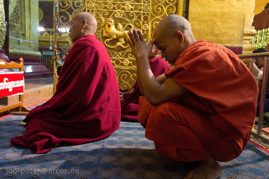 monks praying in Mahamuni pagoda  ,Mandalay, Myanmar, 2011
