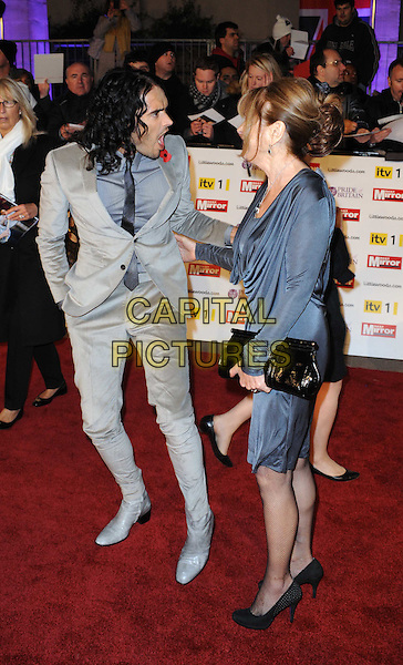RUSSELL BRAND & his Mother BARBARA.Attending the Pride of Britain Awards 2010, Grosvenor House, Park Lane, London, England, UK, .November 8th 2010..arrivals full length mum mom son family grey gray suit dress blue arm around black clutch bag tie mouth open funny .CAP/WIZ.© Wizard/Capital Pictures.