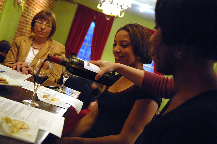 From left, Gerri Hanna of Alexandria, Ashley Futrell of Southwest, and Luciana Mashore of Northeast, attend a wine tasting at Sova, an espresso and wine bar on H Street, NE.