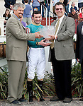 Feb 2011:  Steve Asmussen, left, Gerard Melancon, center, and Frank Brigtsen after winning the Fair Grounds Handicap at the Fairgrounds in New Orleans, Louisiana.