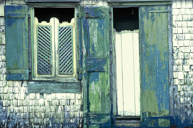 Faded, weathered, facade of old Caribbean Island house.