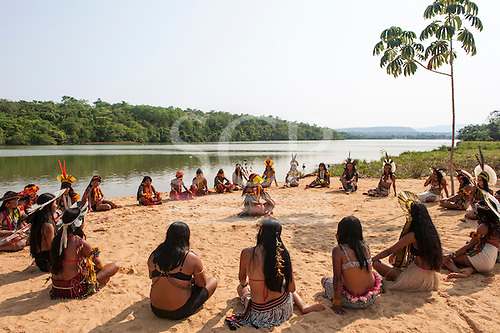 Brazilian indigenous women sit in spiritual preparation for the swimming event at the International Indigenous Games in Brazil. 29th October 2015