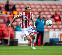 27th June 2020; Bet365 Stadium, Stoke, Staffordshire, England; English Championship Football, Stoke City versus Middlesbrough; James McClean of Stoke City chases a loose ball